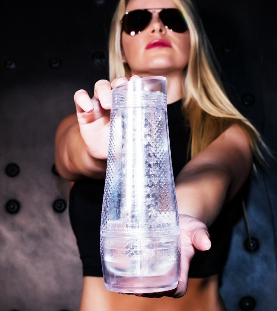 A woman holding the Fleshlight Aviator (pocket pussy)