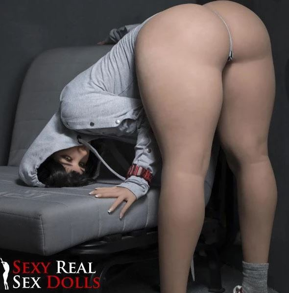 Best curvy sex doll bending over with her legs not bent and head on the couch